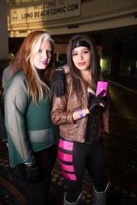 Rogue and Gambit X-Men cosplayers stop for a shot in the convention center lobby.