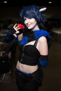 Sincerely Sam, a cosplayer and vendor I met in the artist's alley, shows off her own Cheshire Cat with a smile and a flourish.